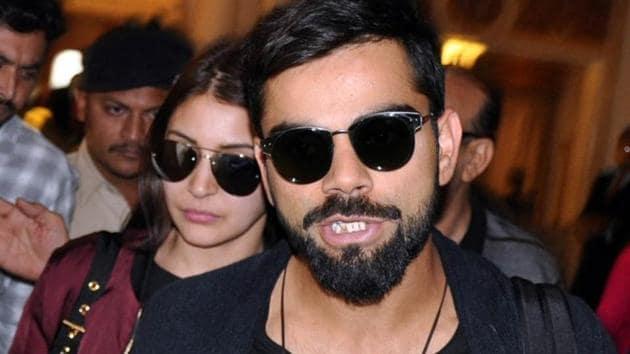 Indian test captain Virat Kohli with actor Anushka Sharma arrive at a hotel in Rajkot in November.(IANS)