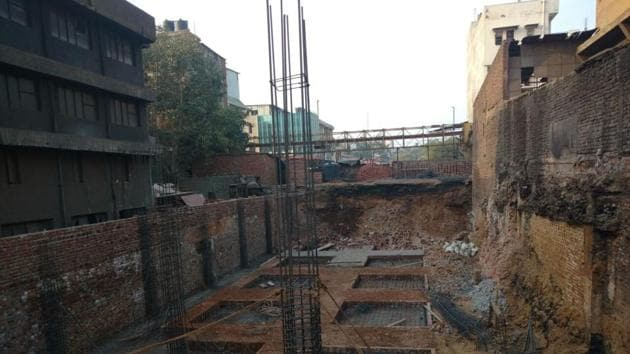 One person was killed and five others injured, when the wall of an under construction building collapsed in southeast Delhi's Okhla Industrial area on Saturday morning.
