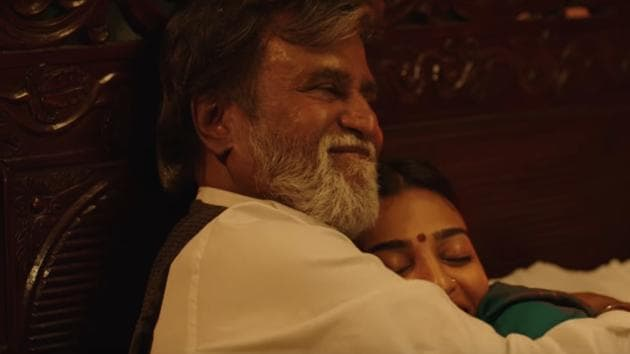 One of the scenes released show Kabali sharing a romantic moment with his wife, Kumudha played by Radhika Apte.(YouTube Grab)