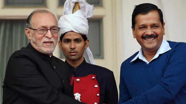 Delhi Chief Minister Arvind Kejriwal greets Anil Baijal after he was sworn in as the New Lieutenant Governor at Raj Niwas in New Delhi on Saturday.(PTI)