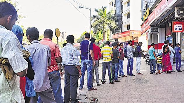 People stand in queue outside a bank ATM to withdraw money in Mumbai on December 10, 2016. Such queues had become a common sight after November 8, the day PM Narendra Modi announced demonetisation.(Pratik Chorge/HT File Photo)