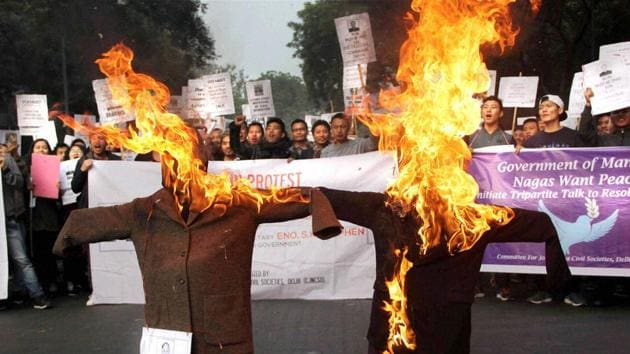 Supporters of United Naga Council stage a protest against Manipur CM Okram Ibobi Singh at Jantar Mantar in New Delhi.(PTI Photo)