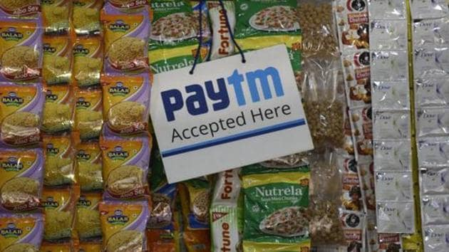 An advertisement board displaying a QR code for Paytm, a digital wallet company, is seen placed at a provision store at Sion in Mumbai.(Kunal Patil/ Hindustan Times)