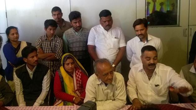 Family members of Sandeep Dange and Ramchandra Kalsangra speaking to media persons in Indore on Sunday.(HT Photo)