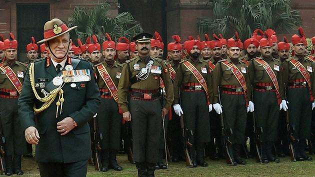 New army chief General Bipin Rawat during the guard of honour at South Block in New Delhi on Sunday.(PTI)