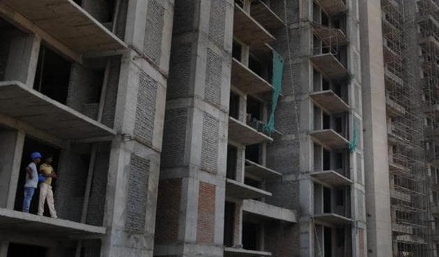 Due to a slowdown in the realty sector, builders were unable to complete their projects, affecting lakhs of homebuyers.(HT Photo)