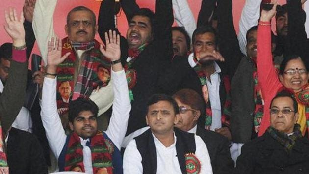 Uttar Pradesh chief minister Akhilesh Yadav with his supporters during the Samajwadi Party's national convention in Lucknow on Sunday.(PTI File Photo)