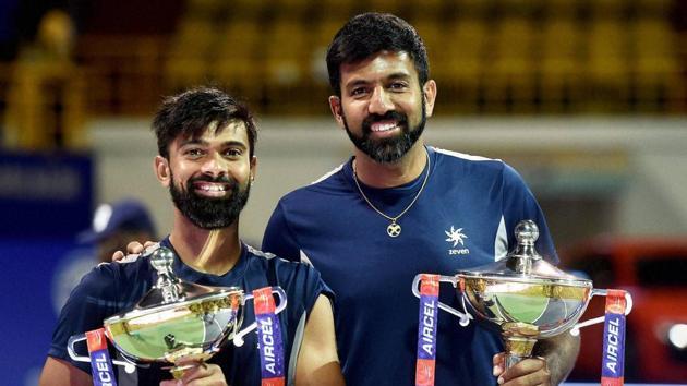 Rohan Bopanna and Jeevan Nedunchezhiyan beat Purav Raja and Divij Sharan 6-3, 6-4 to claim the Chennai Open doubles title.(PTI)