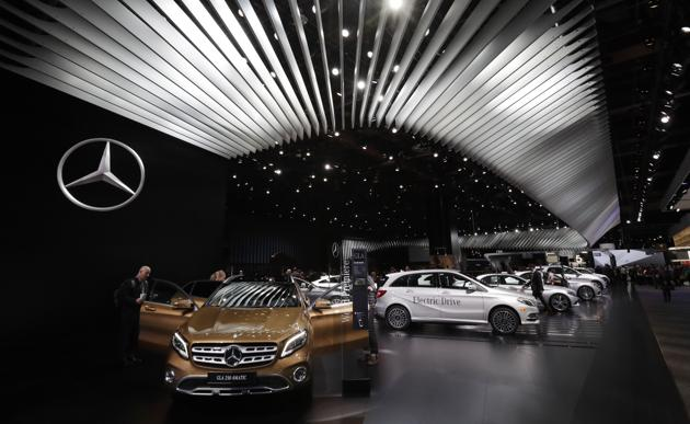 The Mercedes-Benz GLA 250 4Matic, left, is displayed at the North American International Auto show.