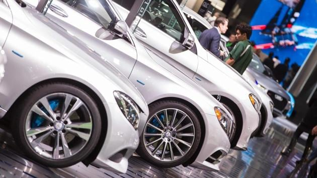 A line of Mercedes sit on display at the 2017 North American International Auto Show in Detroit, Michigan.