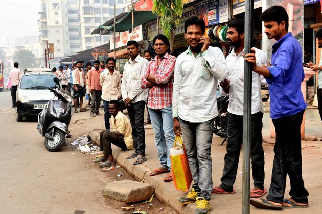 Workers waiting to be hired at Shivaji chowk,Kharghar in Navi Mumbai . After demonetisation, the government will need to think about addressing the urgent needs of this important segment of India' workforce that constitute, among others, construction workers, contractual factory workers and the self-employed like street vendors and small-scale retailers.(Bachchan Kumar/HT)