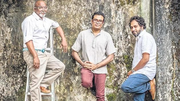 From left: Bose Krishnamachari, Jitish Kallat and Riyas Komu take a break while preparing for the biennale in Kochi. The Kochi Biennale is a fine contemporary illustration of the kind of rooted cosmopolitanism that Indians such as Tagore and Gandhi once practised.(Photo courtesy: Kochi Biennale Foundation)