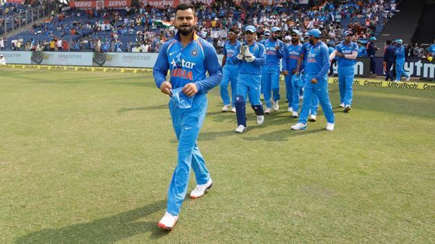 India national cricket team captain Virat Kohli leads the team into the ground at the start of the 1st ODI vs England in Pune on Sunday.(Deepak Malik/ BCCI/ SPORTZPICS)