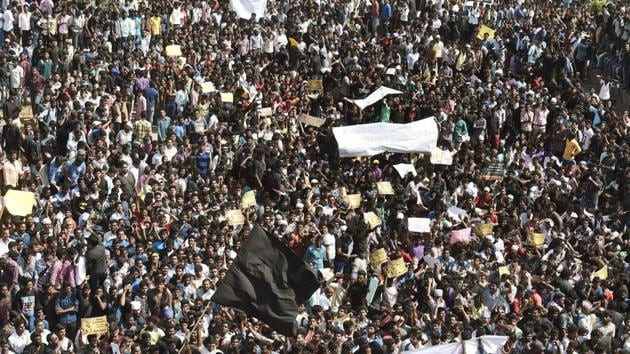 Youngsters and students during a protest to lift the ban on Jallikattu and impose ban on PETA, at Kamarajar Salai, Marina Beach in Chennai on Wednesday.(PTI Photo)