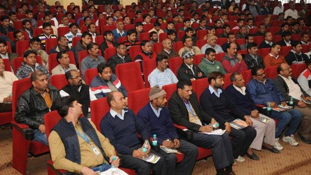 The traffic police on Sunday held a meeting with bus owners and drivers of school buses at Indira Gandhi Kala Kendra in Sector 6 to educate them about traffic rules and safety regulations.(Burhaan Kinu/HT PHOTO)