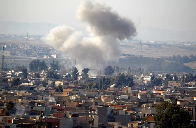 Smoke rises from an airstrike in the Rashidiya neighbourhood in Mosul on Tuesday.(Reuters)