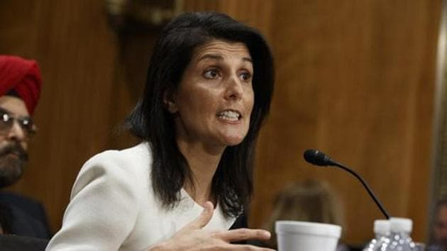 """US President Donald Trump is pleased that Nikki Haley, sworn in as the US ambassador to the UN, """"is our nation's first Indian-American cabinet level officer.""""(AP File Photo)"""