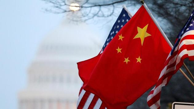 The People's Republic of China flag and the US Stars and Stripes fly along Pennsylvania Avenue near the US Capitol in Washington, DC.(Reuters File Photo)