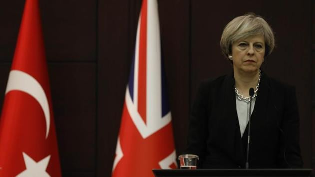 Britain's Prime Minister Theresa May listens to her Turkish counterpart Binali Yildirim (not pictured) during a joint news conference in Ankara, Turkey.(Reuters Photo)
