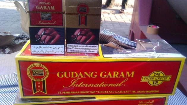 The intelligence agency seized Gudan Garam cigarettes which were wrongly declared as polypropylene injections.(HT Photo)