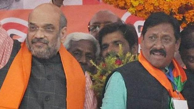 BJP National President Amit Shah with former India cricketer and BJP leader Chetan Chauhan at an election rally in Amroha.(PTI)
