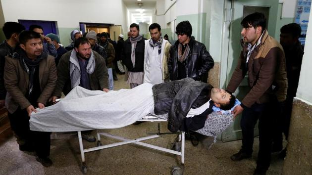 Men carry an injured man to a hospital after a bomb blast in Kabul, Afghanistan February 7, 2017. REUTERS/Mohammad Ismail(REUTERS)