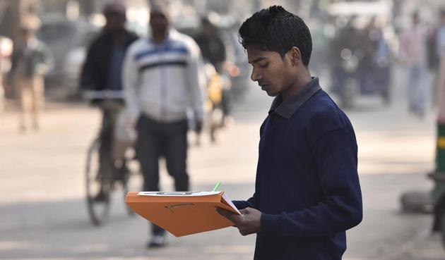 A volunteer conducts the survey on Anath Road.(Sanjeev Verma/HT PHOTO)
