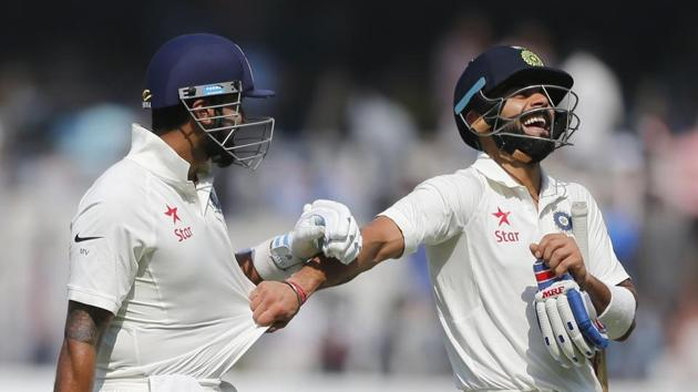 Virat Kohli (right) scored his 16th century in the India vs Bangladesh one-off Test in Hyderabad.(AP)