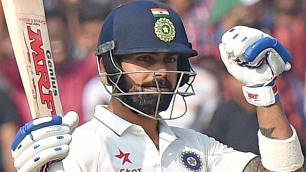 Virat Kohli celebrates after scoring his double century in the one-ff Test match against Bangladesh.(PTI)
