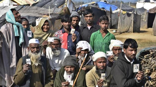 Displaced victims of the Muzaffarnagar riots show their voter cards and unique IDs in Manawwar Hasan Colony of Kairana, Uttar Pardesh.(HT File Photo)