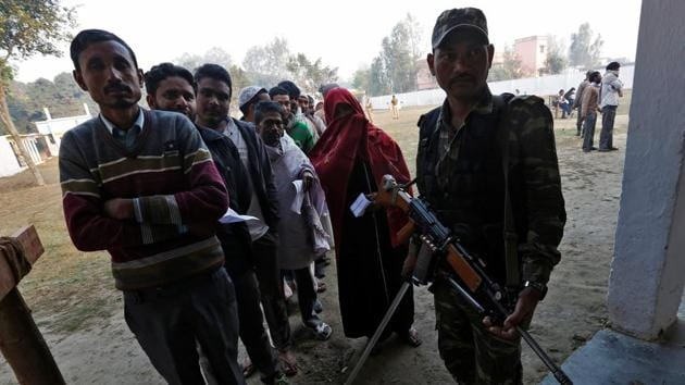 People queue up to cast their vote at a polling station in Uttar Pradesh.(Reuters Photo)