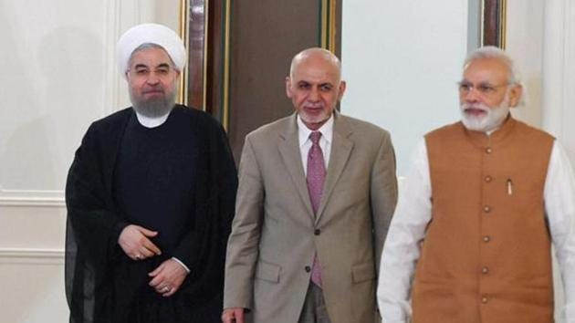 Prime Minister Narender Modi (R) with Iranian President Hassan Rouhani (L) and Afghanistan President Ashraf Ghani after Trilateral meeting in 2016.(PTI photo)