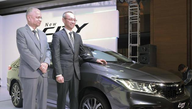 Chief Executive and President of Honda Cars India Ltd, Yoichiro Ueno with SVP & Director Honda Cars India Ltd, Raman Kumar Sharma (R) pose for a photograph during the launch of Honda City 2017 car in New Delhi.