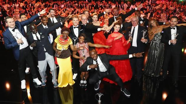 The winners of the Laureus World Sports Awards perform Usain Bolt's trademark celebratory move at the gala in Monaco on Tuesday. Bolt was adjudged the sportsman of the year while US gymnast Simone Biles won the sportswoman of the year award.(Laureus World Sports Awards)