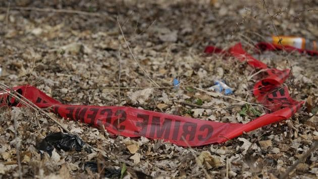 Police tape litters the ground at the scene of a February 14 shooting that killed a toddler and a man. Chicago police are examining dramatic video that captured the killing and was streamed live on Facebook. It was taken from inside a car driven by a young woman who was wounded in the shooting.(AP)