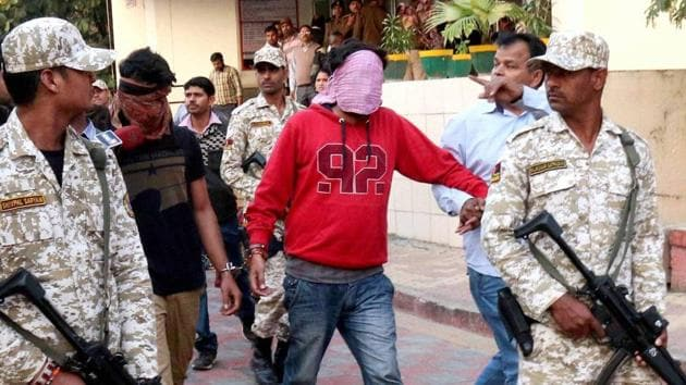 Officials of the Madhya Pradesh Anti-Terrorism Squad escort members of the spying ring to the Bhopal district court.(PTI File)