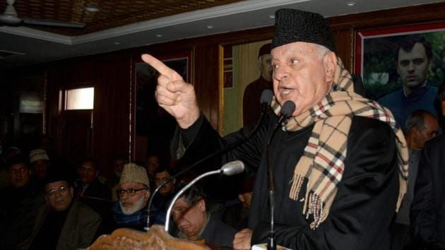 National Conference president Farooq Abdullah addresses party workers at a meeting organised to commemorate the death anniversary of a party leader in Srinagar on Friday.(PTI)