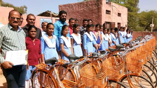 A group of class 9 girls at a government school in Kota have now been gifted the new bicycles under a state government initiative to check the drop out rate.(HT Photo)