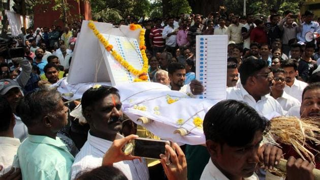 Candidates of various political parties during a symbolic funeral march of electronic voting machine in Pune on Tuesday(HT)