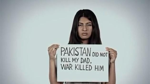 A screengrab of a video posted by Gurmehar Kaur in which she used placards to convey a message of peace between India and Pakistan.