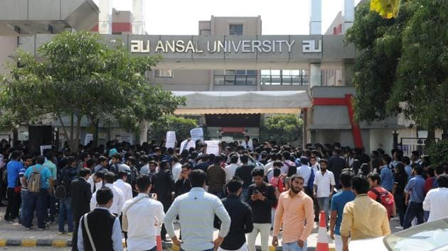 Students of Ansal University in Sector 55 stage a protest against the extra fee being collected by the university authorities.(Parveen Kumar/HT)