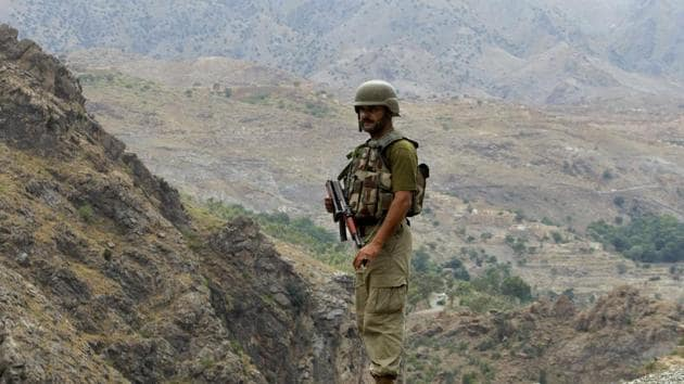 File photo of a Pakistani soldier standing guard in the tribal area of Khyber, near the Torkham border crossing between Pakistan and Afghanistan. On Thursday, March 2, 2017Pakistan's cabinet approved a set of reforms that will bring the tribal regions under government control.(AP)