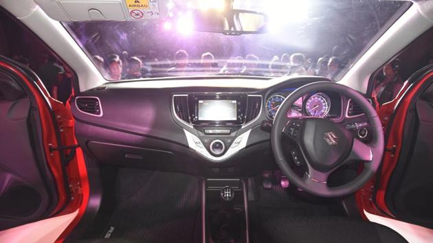 The new Baleno RS has a brushed aluminium centre console. The large touchscreen in the centre comes with built-in navigation and Apple CarPlay. (Sonu Mehta/HT PHOTO)