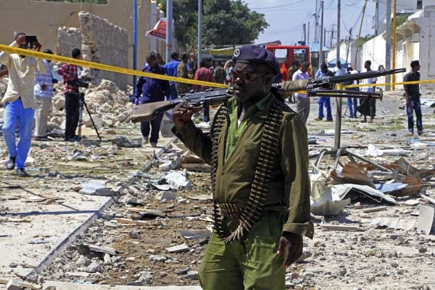 A soldier patrols the area of a suicide car bomb attack in Mogadishu that was reportedly carried out by al-Qaida-linked militants.(AP File/ Representational Photo)
