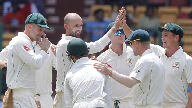 Nathan Lyon celebrates after picking a wicket on Day 1 of the India vs Australia second Test in Bangalore. Get highlights of India vs Australia 2nd Test here.(BCCI)