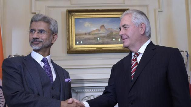 US secretary of state Rex Tillerson shakes hands with foreign secretary S Jaishankar at the State Department in Washington.(AP Photo)