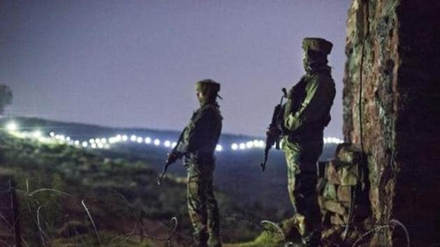 Indian Army soldiers at forward posts beyond the illuminated fence in Hamirpur area near Bhimber Gali, about 180 km north west of Jammu.(Gurinder OsanHindustan Times)