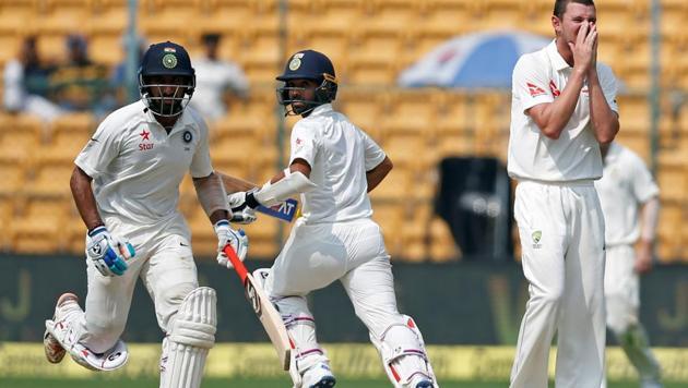 Cheteshwar Pujara and Ajinkya Rahane shared a 93-run stand on Day 3 of the India vs Australia second Test in Bangalore on Monday.(REUTERS)