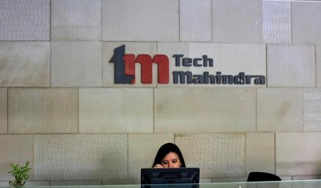 An employee sits at the front desk inside Tech Mahindra office building in Noida on the outskirts of New Delhi.(Reuters file photo)