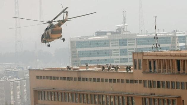 Afghan National Army soldiers descend from a helicopter on the roof of a military hospital in Kabul that was attacked by Islamic State fighters on March 8, 2017.(Reuters)